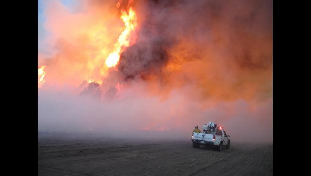 This is a file photo from 2012. This photo was taken at the Wellnitz fire in northwest Sheridan County. Some 77,000 acres in Nebraska and South Dakota were affected by the fire, which was caused by lightning starting on Aug. 29. A total of 39 fire departments and 350 personnel from cooperating agencies in Nebraska responded to the fire. Photo courtesy of Nebraska Forest Service.