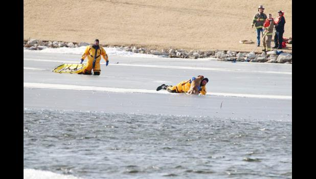 Creston firefighters saved the life of a three-year-old lab after it ran onto Summit Lake and fell into the freezing water. Photo by Cindy Young of the Creston News-Advertiser.