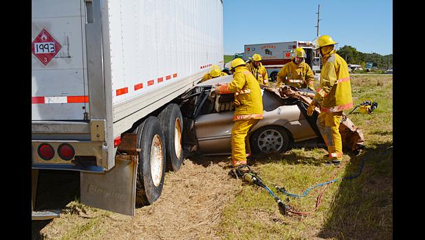 Dwight Firemen performing extrication. Photo courtesy of Colleen Zajac, Dwight EMT.