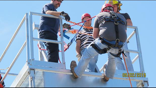 The rappelling tower got used for the first time at the Meade fire school. Photo by Dan Romine.